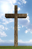 3d wooden cross in field Stock Photo