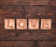 3D Wooden Letters Forming Word LOVE Written On Wooden Background. St. Valentine&x27;s Day. Royalty Free Stock Image