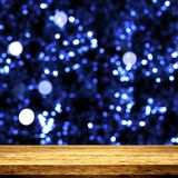 3D wooden table looking out to a bokeh lights background stock illustration