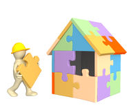 3d working puppet building the house Royalty Free Stock Photography