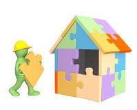 3d working puppet building the house Stock Images