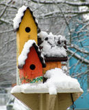 3tier birdhouse. Winter scene with snow capped birdhouse royalty free illustration