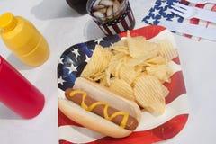 4ème du repas de hot dog de juillet Images libres de droits