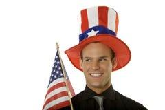 4ème s'usant de jeune homme du chapeau de juillet Photographie stock libre de droits
