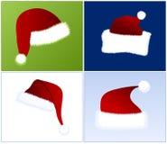 4个不同帽子圣诞老人 免版税库存照片