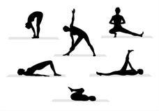 4个剪影瑜伽 免版税库存照片