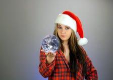 4个女孩辅助工s青少年的圣诞老人 免版税库存图片