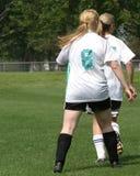 4个比赛女孩足球 免版税图库摄影