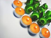 4个苹果蜡烛 库存图片