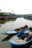 4条小船捕鱼 库存图片