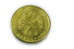 4棵三叶草幸运硬币的叶子 免版税库存图片