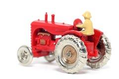 4辆汽车哈里斯massey老玩具拖拉机 库存图片