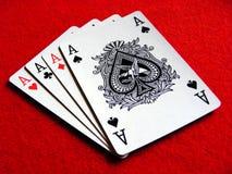 4 överdängare hand poker Arkivfoton