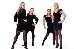 4 κυρίες θέτουν προκλητι&ka Στοκ Εικόνες
