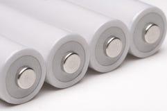 4 двойное батареи на белой предпосылке. Стоковое Изображение