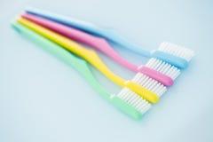 4 пестротканых зубной щетки Стоковые Изображения RF