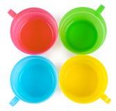4 пластичных чашки с ручками Стоковое Изображение RF