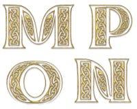 4 прописных золотистых письма Стоковая Фотография