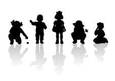 4 силуэта детей Стоковая Фотография RF