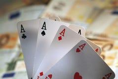 4 тузы и наличной деньг денег. Стоковая Фотография