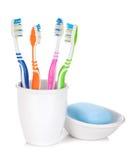 4 цветастых зубные щетки и мыла Стоковое Изображение RF
