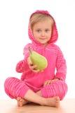 4 años de la muchacha con la pera Foto de archivo