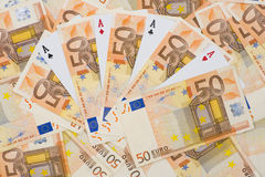 4 aces and euros Stock Photos