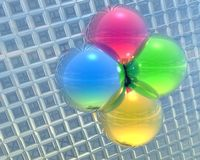 4 bright color balls on a grid Stock Images