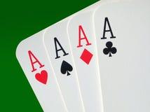 4 cartes de tisonnier d'as se ferment vers le haut. Image stock