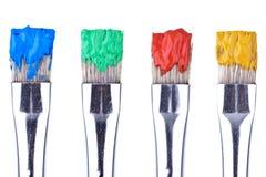 4 cepillos de pintura Fotografía de archivo libre de regalías
