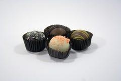 4 chocolates en el fondo blanco Foto de archivo libre de regalías