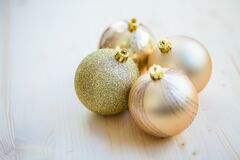 4 Christmas Baubles on Beige Wooden Flooring Stock Photography