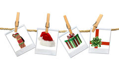 4 Christmas Related Photos Hanging on a Rope Stock Image
