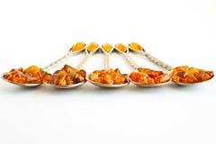 4 cuillères ambres Images libres de droits