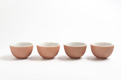 4 cups for tea. Rosy ceramic tea cups set on white background Royalty Free Stock Photography