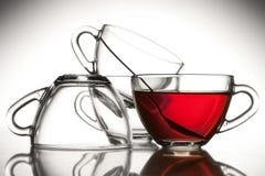 4 cuvettes de thé et thés Photographie stock libre de droits