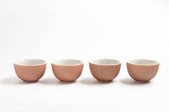 4 cuvettes pour le thé Photographie stock libre de droits