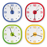 4 design clocks in 4 colors. Blue, green, red , ye Stock Photography