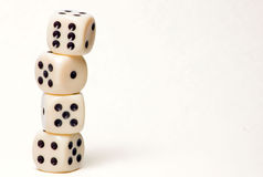 4 dice piled up in front of white background Stock Photography