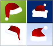 4 different Santa hats Royalty Free Stock Photos