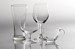 4 empty glasses in different style stock photos