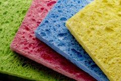 4 esponjas coloridas Imagem de Stock
