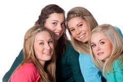 4 filles sur le blanc Photo stock