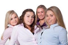 4 filles sur le blanc Images libres de droits