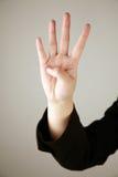 4 fingrar numrerar uppvisning Fotografering för Bildbyråer