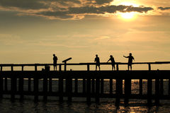 4 fisherman on jetty Royalty Free Stock Photos