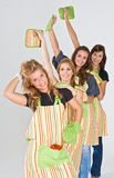 4 Girls Ready to Cook. Four girls wearing aprons and ready to cook Royalty Free Stock Images