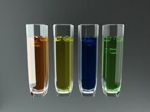 4 glaces avec les liquides colorés Image stock