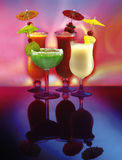 4 happy umbrella drinks Stock Image