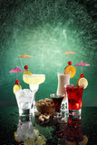 4 happy umbrella drinks and pistachio Stock Photo